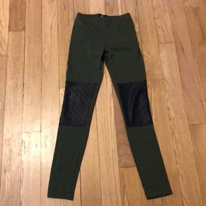 Green BDG leggings with black knee patches